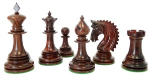 Six black chess pieces